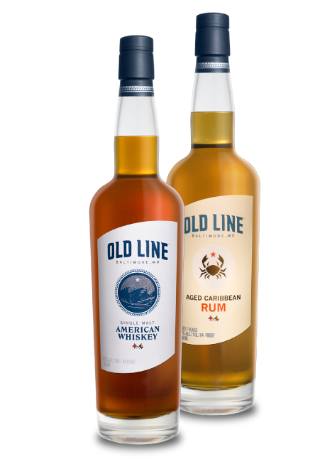 Old Line Single Malt Whiskey And Aged Caribbean Rum Bottles